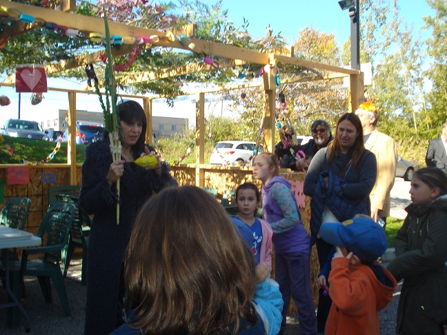 Spiritual Leader Audrey Kaufman leads the Sukkot celebration small